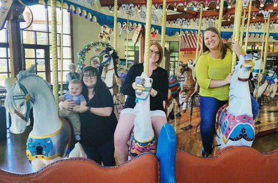 Never too young (or old!) for a carousel ride.